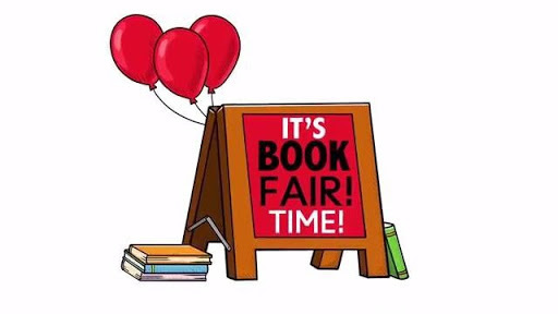 sandwich board that says book fair