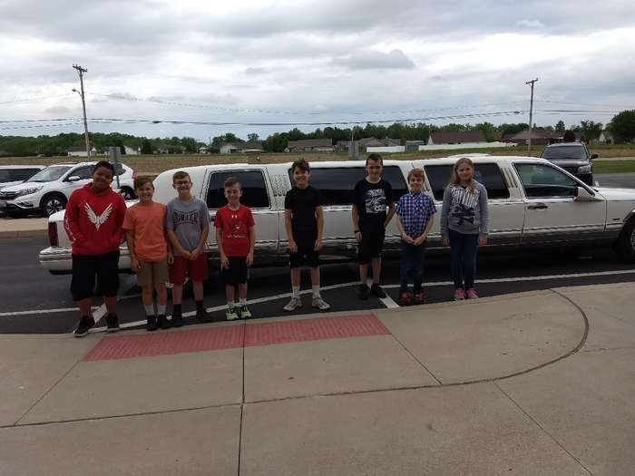 kids in front of a limo