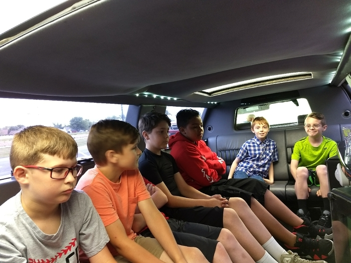 kids riding in the limo