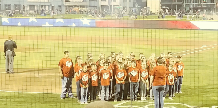 Miss O and MUES choir students at the Dragon's game.