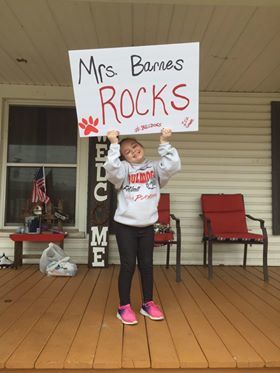 "Mrs. Barnes ""Rocks"" Poster Held by Student"
